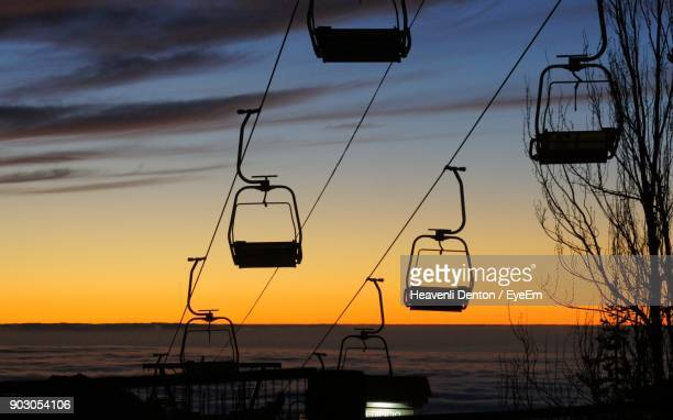 Silhouette Ski Lift Against Sky During Sunset