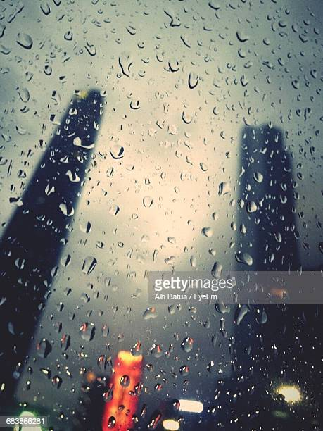Silhouette Skyscrapers Seen Through Wet Glass Window