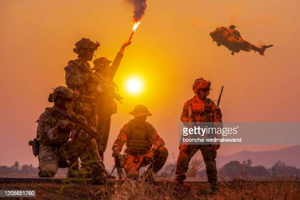 silhouette soldiers on the sunset sky background - crime stock pictures, royalty-free photos & images