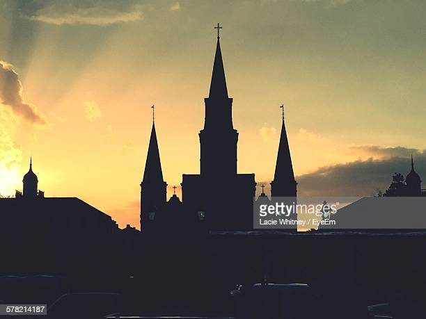 silhouette st louis cathedral against sky at sunset - catholicism stock pictures, royalty-free photos & images