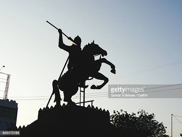 Silhouette Statue Of Army Soldier On Horse Against Clear Sky
