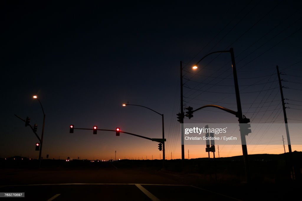 Silhouette Stoplights Against Sky During Sunset : Stock-Foto