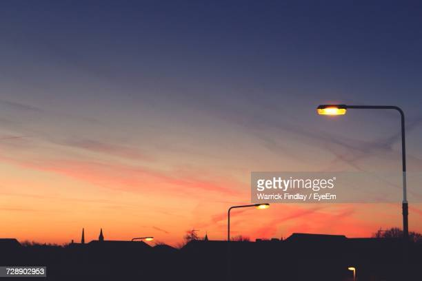 silhouette street light against sky at night - street light stock pictures, royalty-free photos & images