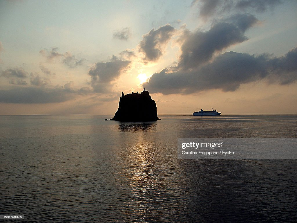 Silhouette Strombolicchio And Sea Against Sky During Sunset : Foto stock