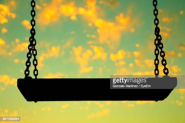 Silhouette Swing Against Sky At Sunset