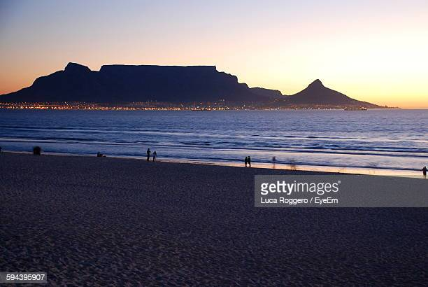 Silhouette Table Mountain By Sea During Sunset
