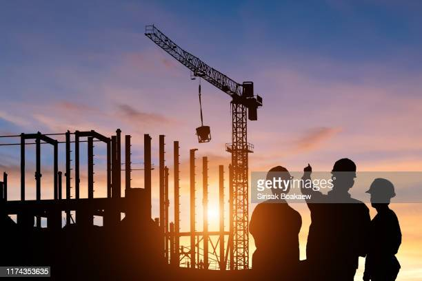 silhouette teams of business engineers looking for blueprints in construction - council flat stock pictures, royalty-free photos & images
