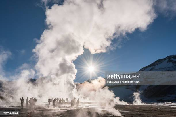 silhouette tourists at tatio geysers, san pedro de atacama, chile - chile stock photos and pictures