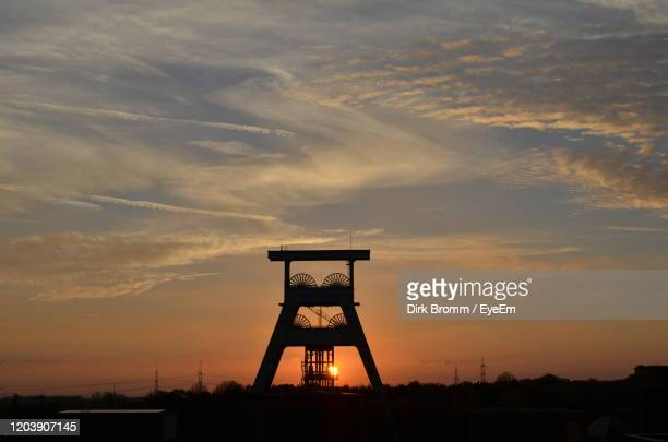 silhouette tower against sky during sunset - ruhr stock pictures, royalty-free photos & images