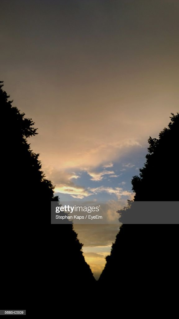 Silhouette Valley Against Cloudy Sky During Sunset : Stock Photo