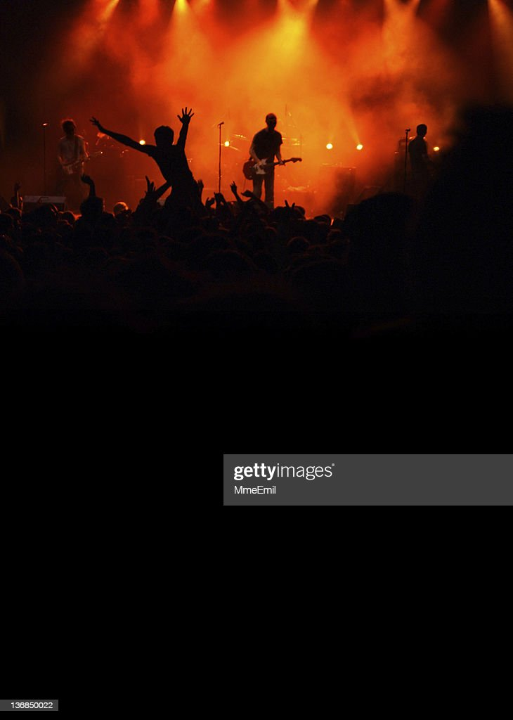 Silhouette view of a band and concert goers at rock concert : Stock Photo