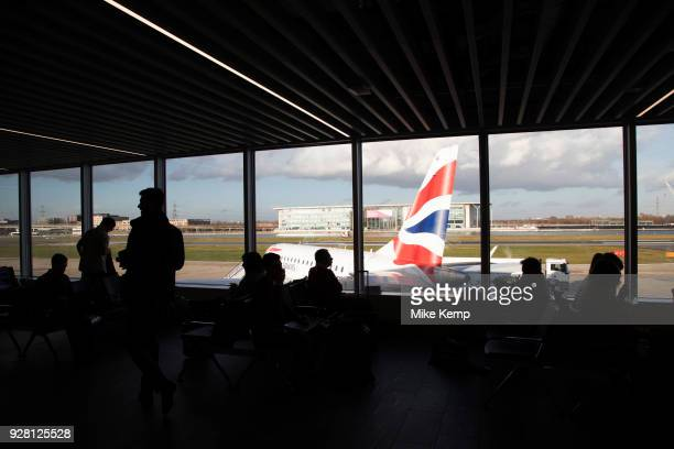 Silhouette view of passengers waiting in the terminal building for their British Airways flights from London City Airport in London, England, United...