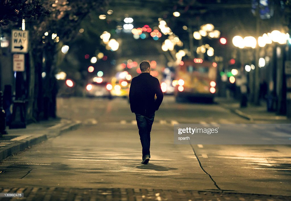 Silhouette walking in downtown seattle : Stock Photo