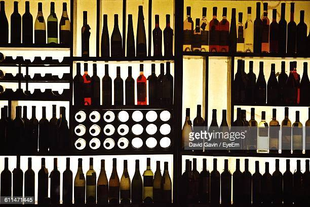silhouette wine bottles on shelf - back lit stock pictures, royalty-free photos & images