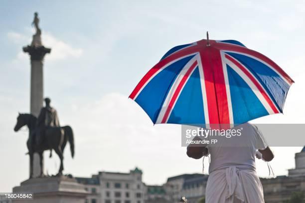 Silhouette with UK flag umbrella at Trafalgar Sq