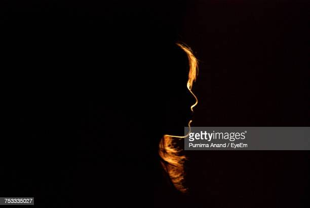 silhouette woman against black background - back lit stock pictures, royalty-free photos & images