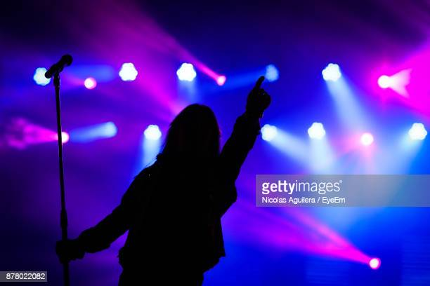 silhouette woman at music concert - singer stock pictures, royalty-free photos & images