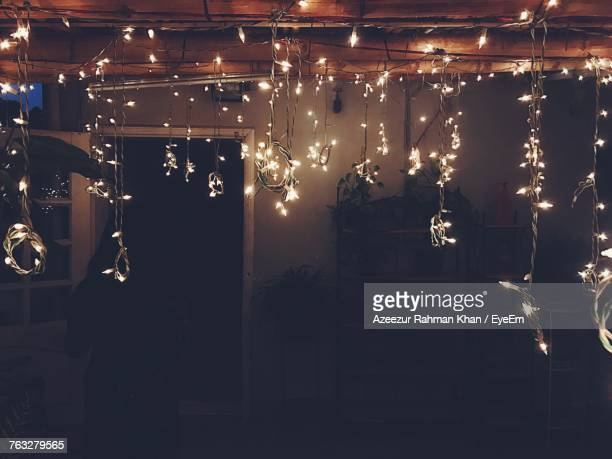 Silhouette Woman By Illuminated Christmas Lights At Home