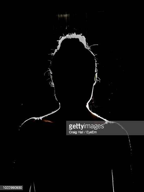 silhouette woman in darkroom - back lit stock pictures, royalty-free photos & images