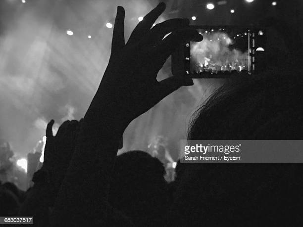 Silhouette Woman Photographing With Smart Phone During Music Concert