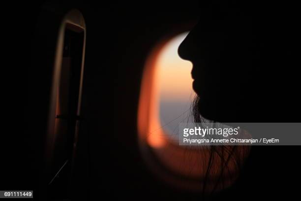 Silhouette Woman Sitting In Airplane