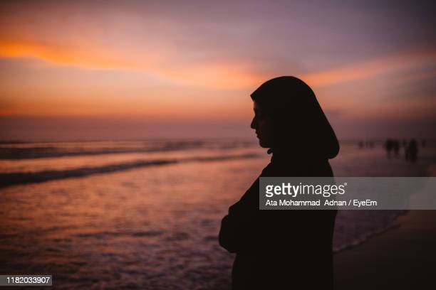 silhouette woman standing at beach during sunset - bangladesh stock pictures, royalty-free photos & images
