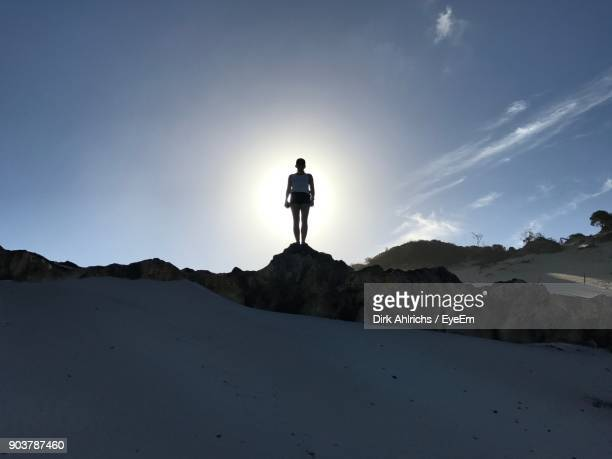 Silhouette Woman Standing On Landscape Against Sky