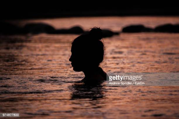 Silhouette Woman Swimming In Sea