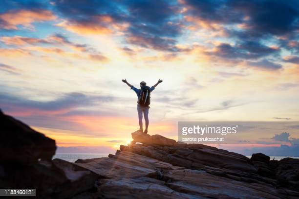 silhouette  women on top of mountain peak , success, winner, leader concept . - summit stock pictures, royalty-free photos & images