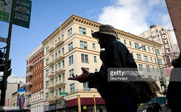 Silhouetted against historical buildings Mark Ellinger photographs some of his favorite architecture in the Tenderloin district of San Francisco on...