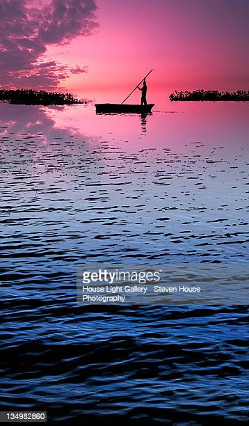 Silhouetted boatman
