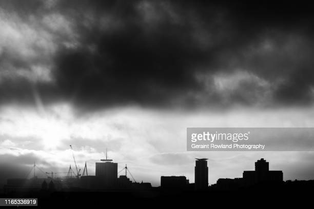 silhouetted cardiff - dramatic sky stock pictures, royalty-free photos & images