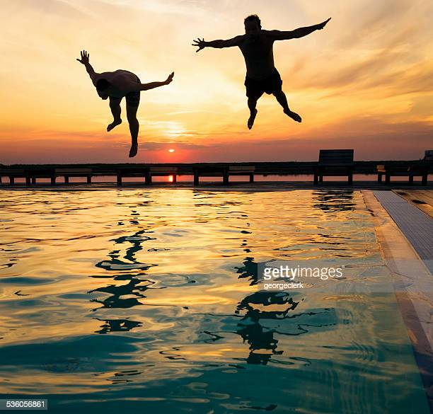 Silhouetted divers at sunset