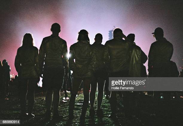 Silhouetted Festival Goers at Night