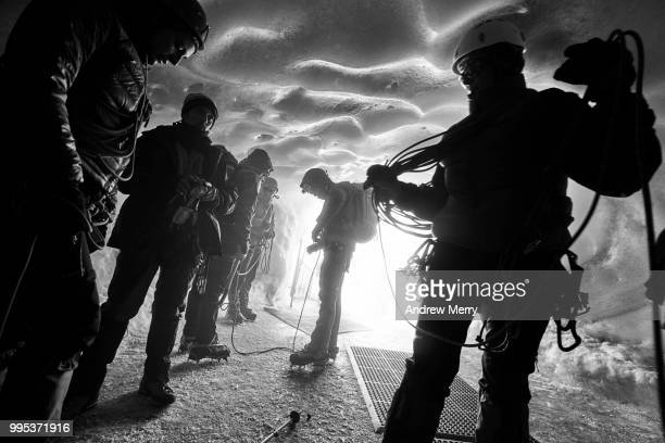 silhouetted group of alps mountain climbers, alpinist, finishing an adventure at aiguille du midi - pinnacle peak stock pictures, royalty-free photos & images
