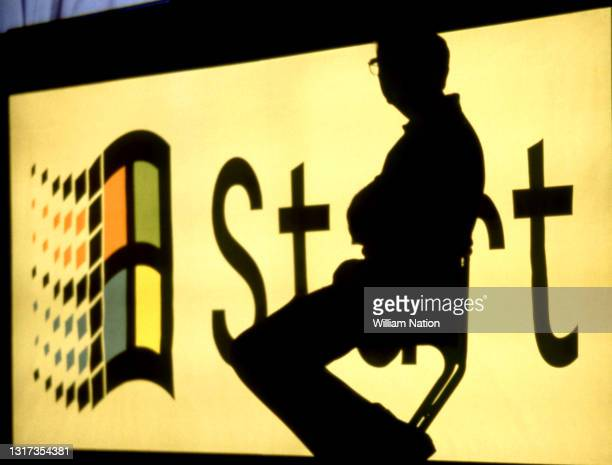Silhouetted image of American business magnate, software developer, investor, author, and philanthropist Bill Gates launches the Windows 95 software...