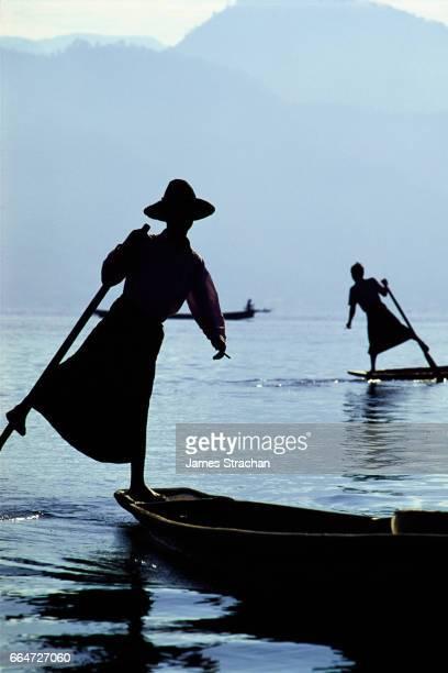 Silhouetted leg-rowers, Inle Lake, Myanmar