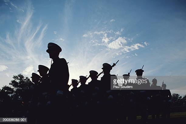 silhouetted naval cadets marching in formation, low angle view - navy stock pictures, royalty-free photos & images