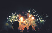 Silhouetted People Watching a Fireworks Display
