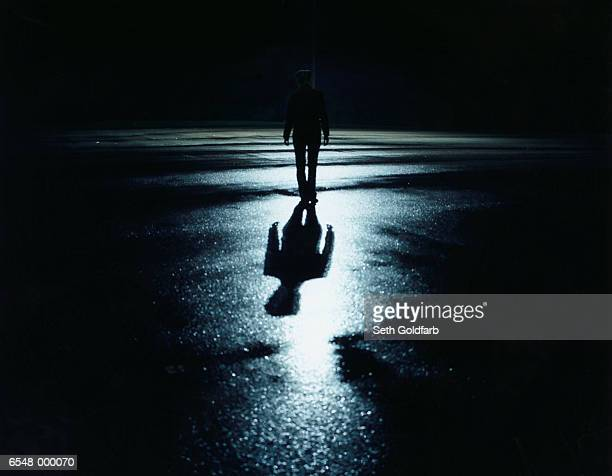 silhouetted person at night - ominous stock pictures, royalty-free photos & images