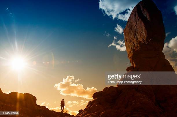 Silhouetted Person Near Balanced Rock in Utah