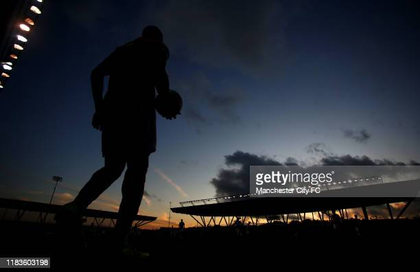 Silhouetted players walks to take a corner during the Premier League 2 between Manchester City v Arsenal at Manchester City Football Academy on...