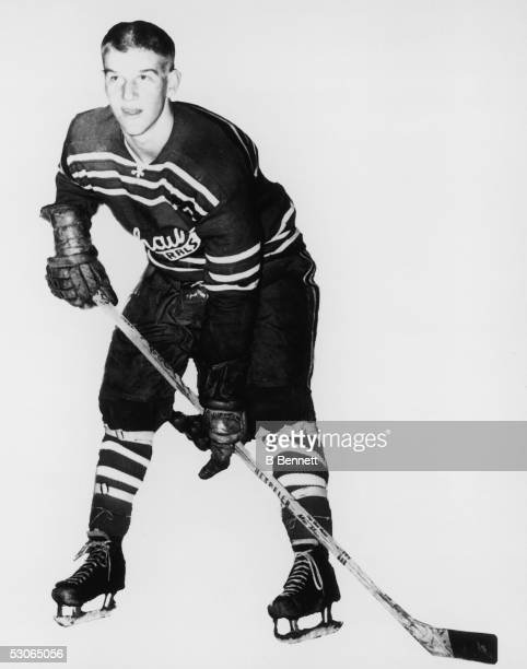 Silhouetted portrait of Canadian professional ice hockey player defenseman Bobby Orr as he poses at the ready with skates stick and gloves in the...