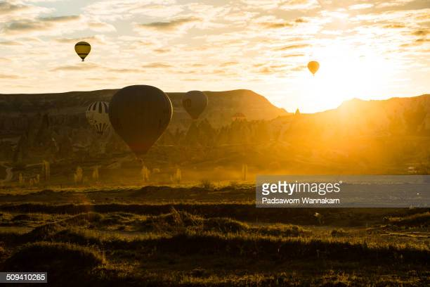 Silhouetted scene of Hot air balloon launching at Goreme Cappadocia Turkey