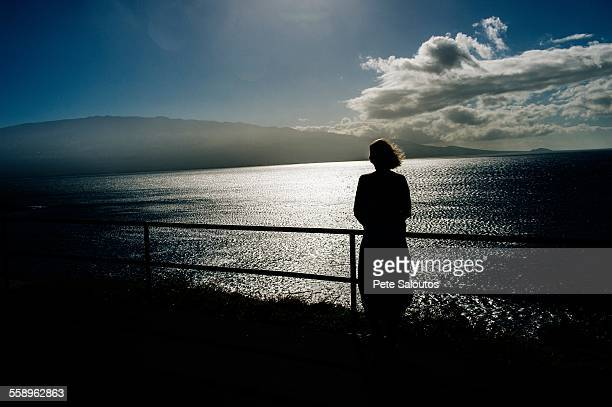 silhouetted senior woman looking out to sea, maui, hawaii - category:census-designated_places_in_honolulu_county,_hawaii stock pictures, royalty-free photos & images