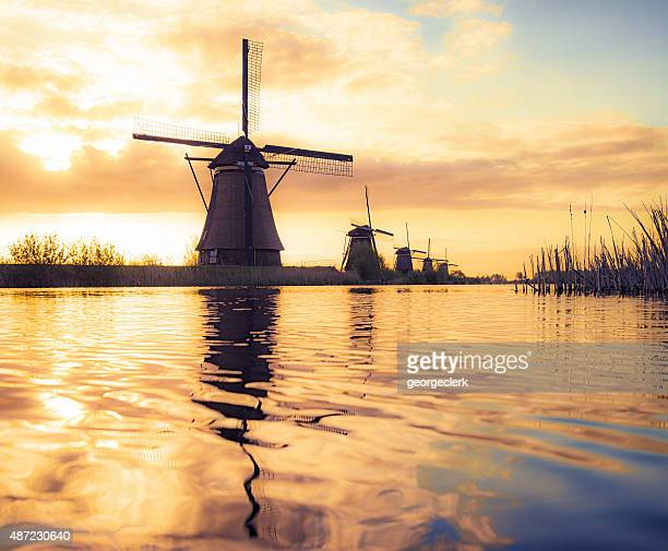 Silhouetted traditional windmills in Holland