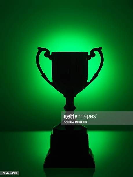 Silhouetted trophy with green background