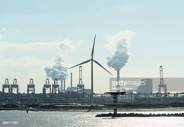 silhouetted view of wind turbine, container terminal and coal fired power plant at rotterdam harbour, netherlands - carbon dioxide bildbanksfoton och bilder