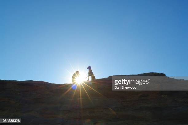 Silhouetted Woman and Dog with Sunburst - Cape Kiwanda, Oregon Coast