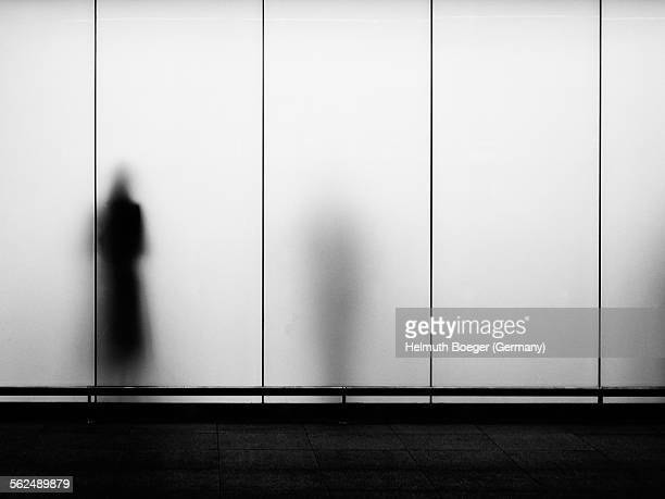 Silhouettes behind frosted glass